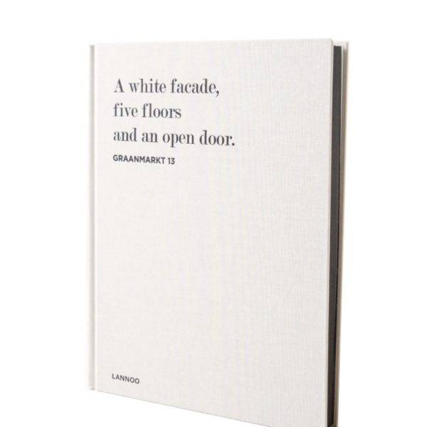 A white facade, five floors and an open door – Journal